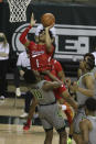 Texas Tech guard Terrence Shannon Jr. (1) attempts a shot past Baylor guard Adam Flagler (10) in the first half of an NCAA college basketball game Sunday, March 7, 2021, in Waco, Texas. (AP Photo/Jerry Larson)