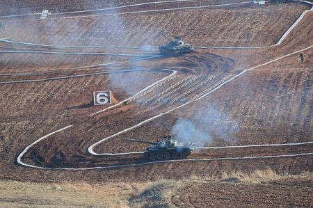 Tanks are seen during the Korean People's Army tank crews' competition at an unknown location. REUTERS/KCNA