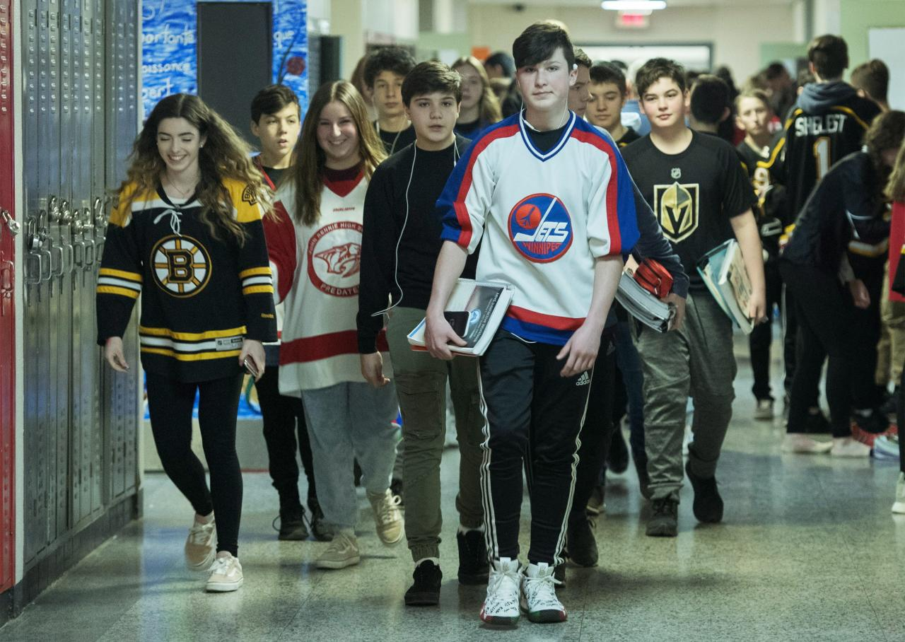 <p>John Rennie high school students wear jersey's at their school in Montreal, Thursday, April, 12, 2018, in honour of the victims of the Humboldt Broncos bus crash.<br />(Photo by Graham Hughes, The Canadian Press) </p>
