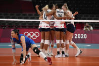 United States teammates celebrate during the women's volleyball preliminary round pool B match between China and United States at the 2020 Summer Olympics, Tuesday, July 27, 2021, in Tokyo, Japan. (AP Photo/Frank Augstein)