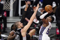 Sacramento Kings guard De'Aaron Fox, right, shoots as Los Angeles Clippers center Ivica Zubac defends during the second half of an NBA basketball game Sunday, Feb. 7, 2021, in Los Angeles. (AP Photo/Mark J. Terrill)