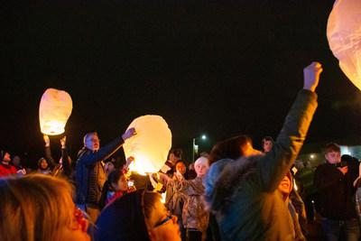 Hormel Foods CEO Jim Snee releases a lantern with several of Jayme Closs' classmates and teachers as light is brought back to Barron, Wisc., during the Lighting of a Tree of Hope for Jayme Closs ceremony. Hormel Foods and Jennie-O Turkey Store partnered with the Barron School District to coordinate the ceremony.