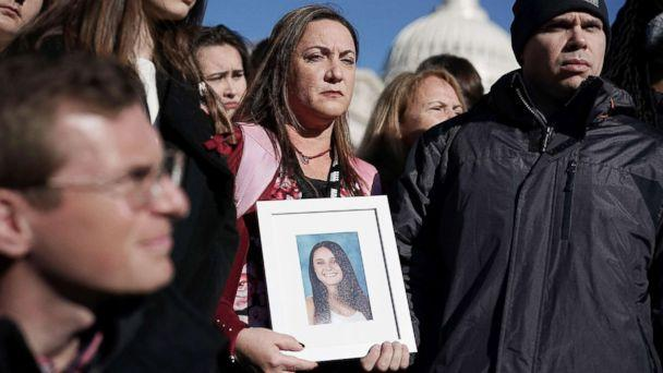 PHOTO: Lori Alhadeff and her husband Ilan Alhadeff right, hold a picture of their daughter Alyssa Alhadeff, a Marjory Stoneman Douglas High School shooting victim, during a news conference on gun control in Washington, D.C., March 23, 2018. (Alex Wong/Getty Images, FILE)