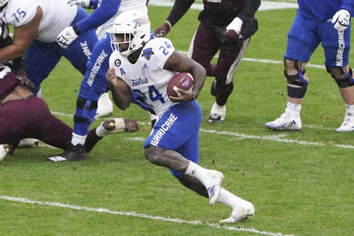 Tulsa running back Corey Taylor II (24) runs the ball against Mississippi State during the first half of the Armed Forces Bowl NCAA college football game Thursday, Dec. 31, 2020, in Fort Worth, Texas. (AP Photo/Jim Cowsert)