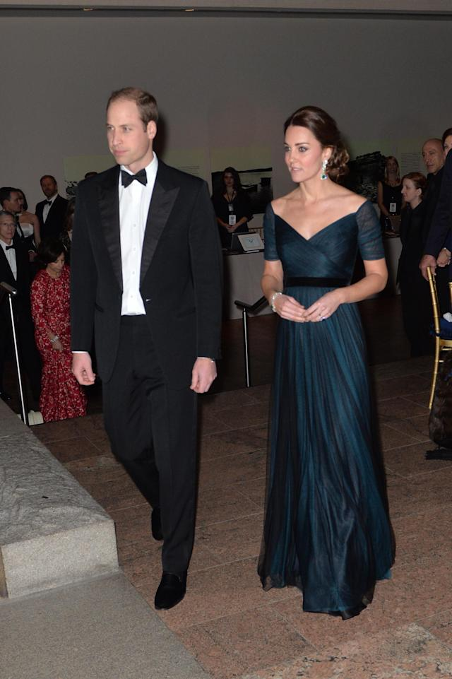 <p>Kate hid her growing baby bump at a dinner, choosing a petrol blue Jenny Packham gown.<br>(Photo: PA) </p>