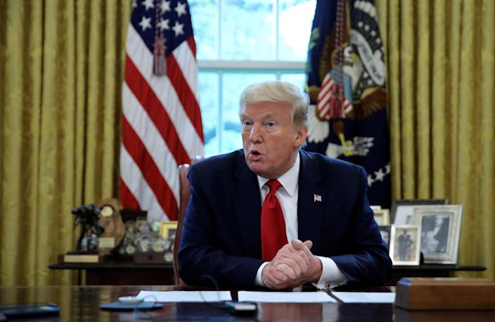 U.S. President Donald Trump answers questions during an interview with Reuters about China, the coronavirus pandemic and other subjects in the Oval Office of the White House, April 29, 2020. REUTERS/Carlos Barria
