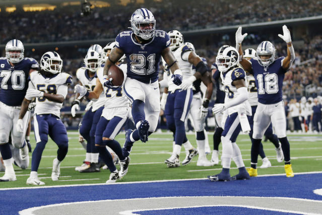 Dallas Cowboys running back Ezekiel Elliott (21) jumps into the end zone with a touchdown against the Los Angeles Rams. (AP Photo/Roger Steinman)