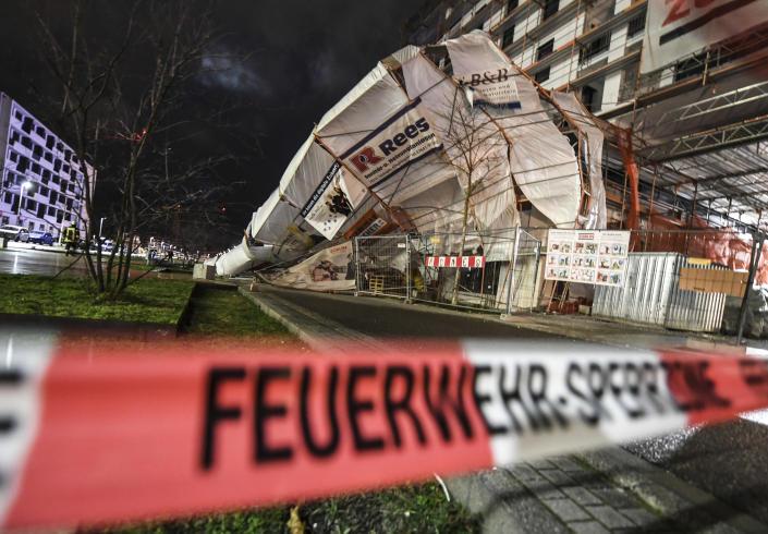 A scaffold has toppled over due to heavy wind in Freiburg, Germany, Monday, Feb. 10, 2020. A storm battered the U.K. and northern Europe with hurricane-force winds and heavy rains Sunday, halting flights and trains and producing heaving seas that closed down ports. Soccer games, farmers' markets and cultural events were canceled as authorities urged millions of people to stay indoors, away from falling tree branches. (Patrick Seeger/dpa via AP)