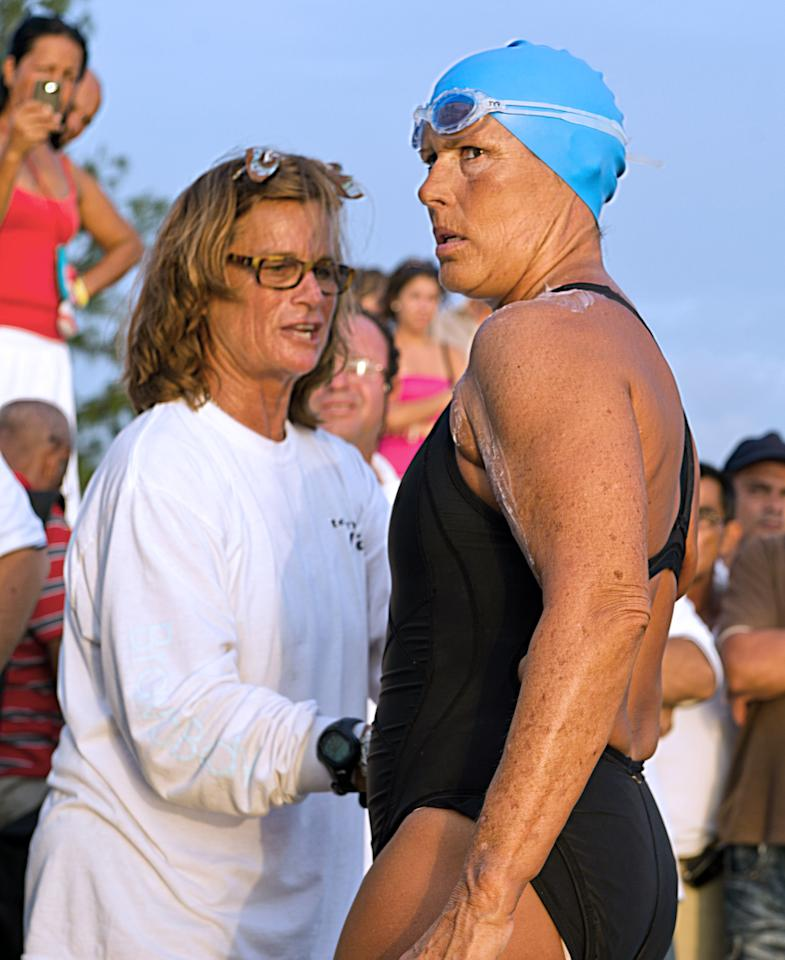 US swimmer Diana Nyad puts cream on at Ernest Hemingway Nautical Club, in Havana on August 7, 2011, before swimming from Havana to Florida in a three-day non-stop journey.  AFP PHOTO/ADALBERTO ROQUE (Photo credit should read ADALBERTO ROQUE/AFP/Getty Images)
