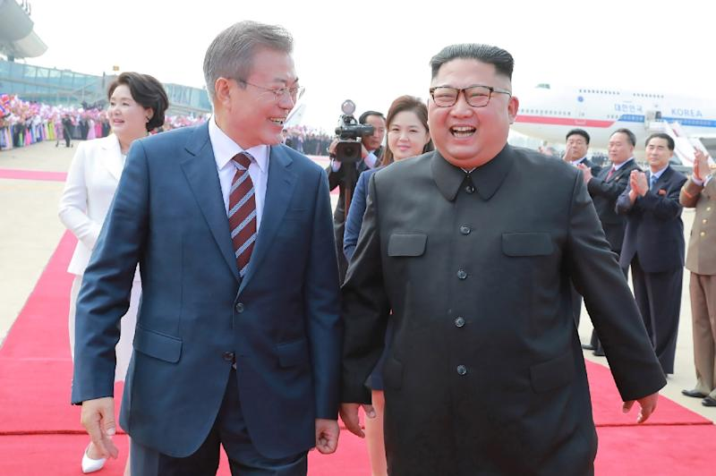 UN sanctions monitors are investigating North Korea's use of luxury vehicles such as Lexus SUVs at the inter-Korean summit between South Korean President Moon Jae-in (L) and Kim Jong Un in September (AFP Photo/KCNA VIA KNS)