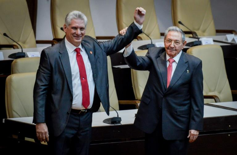 The National Assembly broke into applause as Cuba's new President Miguel Diaz-Canel walked to the front and embraced Raul Castro