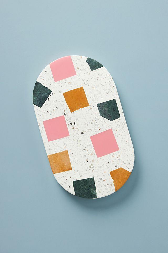 """<p><strong>Anthropologie</strong></p><p>anthropologie.com</p><p><strong>$38.00</strong></p><p><a href=""""https://go.redirectingat.com?id=74968X1596630&url=https%3A%2F%2Fwww.anthropologie.com%2Fshop%2Fterrazzo-cheese-board&sref=https%3A%2F%2Fwww.womansday.com%2Frelationships%2Ffamily-friends%2Fg36467619%2Fbest-college-graduation-gifts%2F"""" rel=""""nofollow noopener"""" target=""""_blank"""" data-ylk=""""slk:Shop Now"""" class=""""link rapid-noclick-resp"""">Shop Now</a></p><p>One of the best parts of adulthood is the dinner parties, and every great dinner party has a charcuterie/cheese tray. Help your grad serve their friends in style with this trendy terrazzo platter.</p>"""
