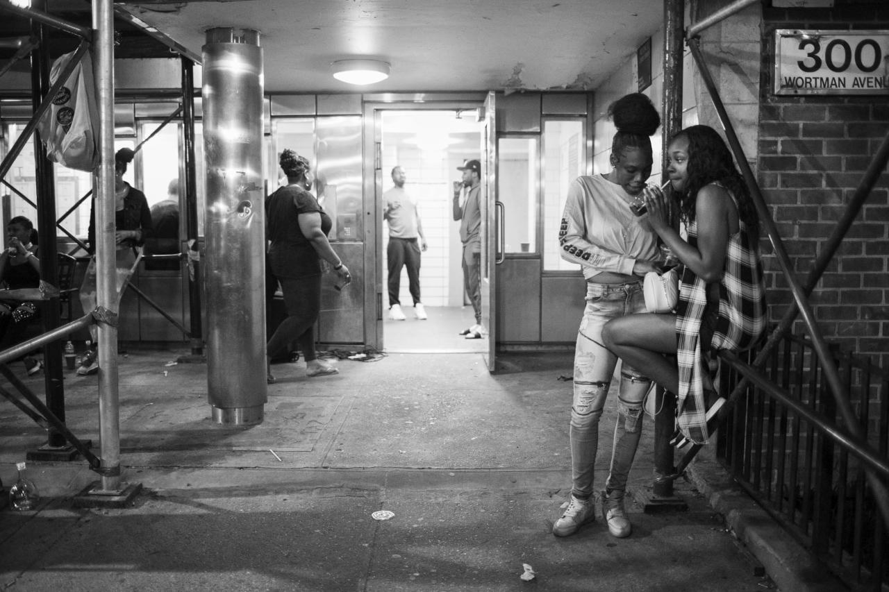<p>Friends and family gather to celebrate the 31st birthday of Rocky, a resident of Linden Houses, E. New York. (Photograph by Amnon Gutman) </p>