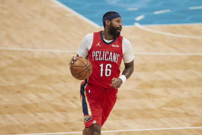 New Orleans Pelicans forward James Johnson (16) brings the ball up during the first half against the Charlotte Hornets in an NBA basketball game Sunday, May 9, 2021, in Charlotte, N.C. (AP Photo/Brian Westerholt)