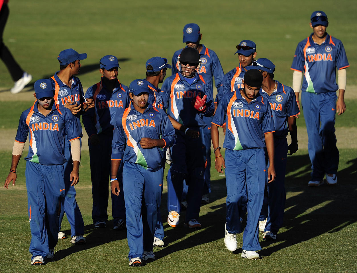 TOWNSVILLE, AUSTRALIA - AUGUST 12:  The Indian team walks off the field after losing the ICC U19 Cricket World Cup 2012 match between the West Indies and India at Tony Ireland Stadium on August 12, 2012 in Townsville, Australia.  (Photo by Ian Hitchcock-ICC/Getty Images)