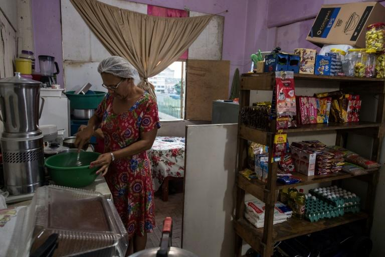 Marcia Goncalves, a squatter in Sao Paulo's Prestes Maia building, makes a living selling sweets and rinks from a small shop set up in her kitchen