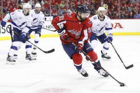 May 21, 2018; Washington, DC, USA; Washington Capitals center Evgeny Kuznetsov (92) skates with the puck as Tampa Bay Lightning right wing Ryan Callahan (24) defends in the third period in game six of the Eastern Conference Final in the 2018 Stanley Cup Playoffs at Capital One Arena. The Capitals won 3-0. Mandatory Credit: Geoff Burke-USA TODAY Sports