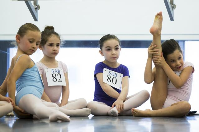 Children sit and wait for their turn during an audition for the School of American Ballet in New York April 25, 2014. The school is holding auditions for over 600 beginner ballet students, who will be selected to fill the 120 spots available to study the dance on campus. REUTERS/Lucas Jackson (UNITED STATES - Tags: SOCIETY EDUCATION)