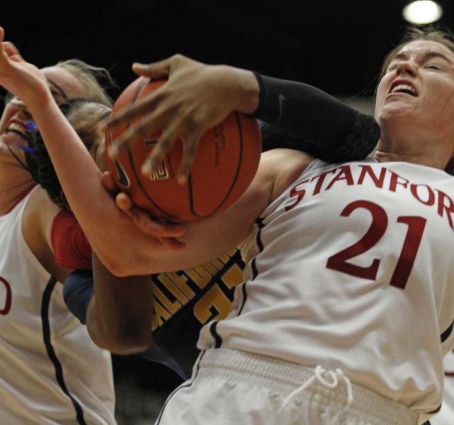 California's Reshanda Grey, center, struggles for the ball with Stanford's, Sara James, right, and Mikaela Ruef during the first half of an NCAA college basketball game, Thursday, Jan. 30, 2014 in Berkeley, Calif. (AP Photo/George Nikitin)