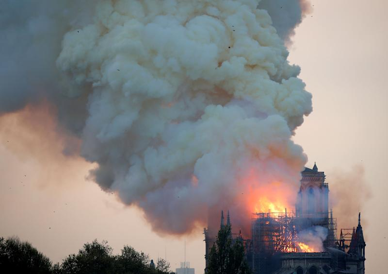 Smoke billows from Notre Dame Cathedral after a fire broke out, in Paris, France April 15, 2019. REUTERS/Charles Platiau