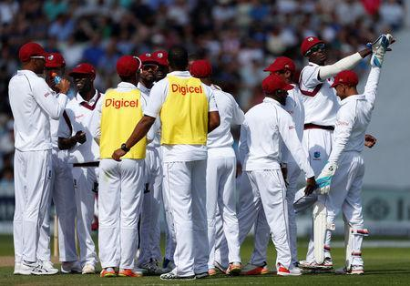 Cricket - England vs West Indies - First Test - Birmingham, Britain - August 17, 2017 West Indies' Jason Holder celebrates the wicket of England's Tom Westley with teammates Action Images via Reuters/Paul Childs