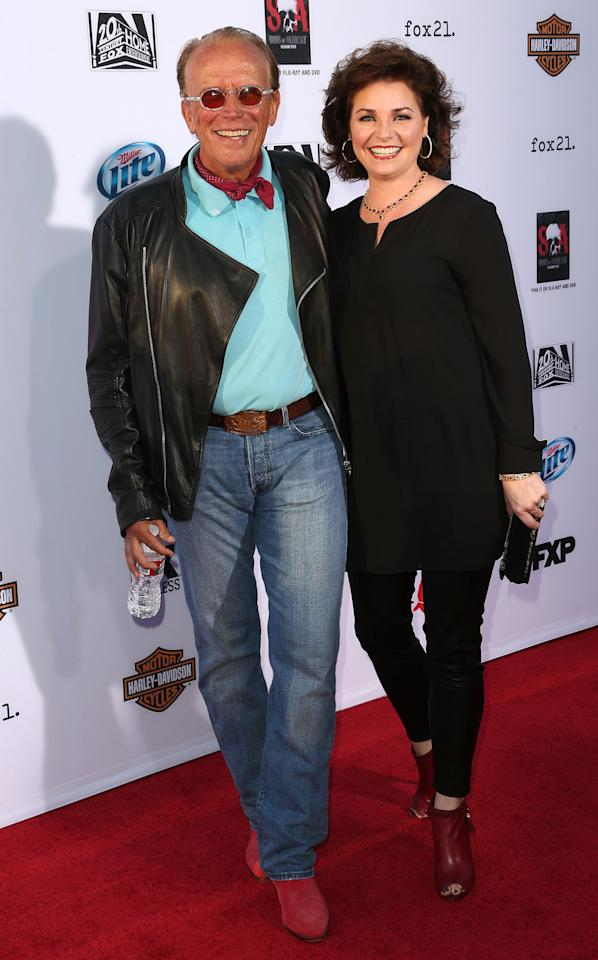 "HOLLYWOOD, CA - SEPTEMBER 07: Actor Peter Weller (L) and his wife attend the Premiere of FX's ""Sons of Anarchy"" Season 6 at the Dolby Theatre on September 7, 2013 in Hollywood, California. (Photo by Frederick M. Brown/Getty Images)"