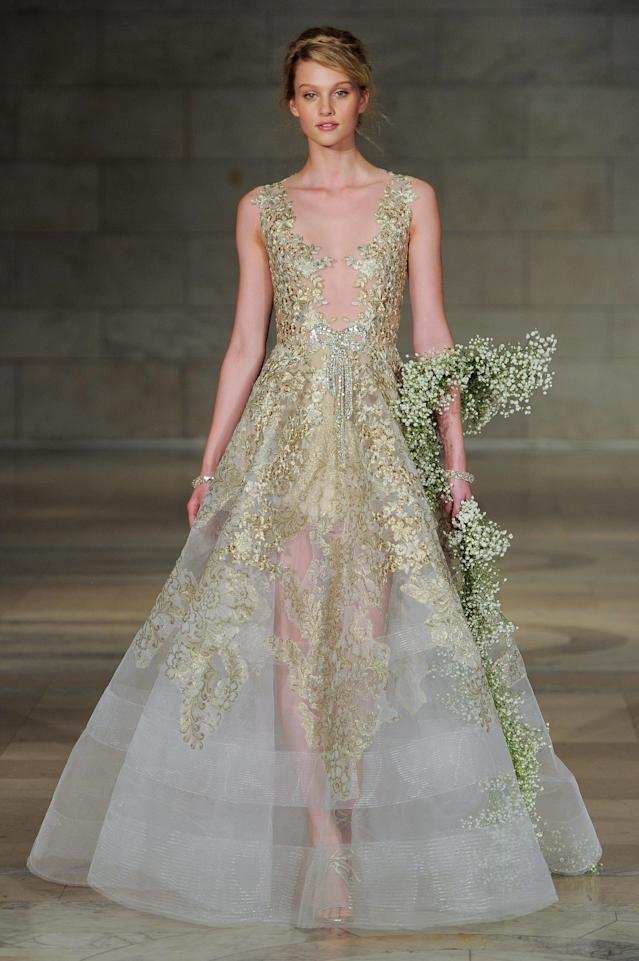 <p>Gold semi-sheer ball gown. (Photo: Maria Valentino) </p>