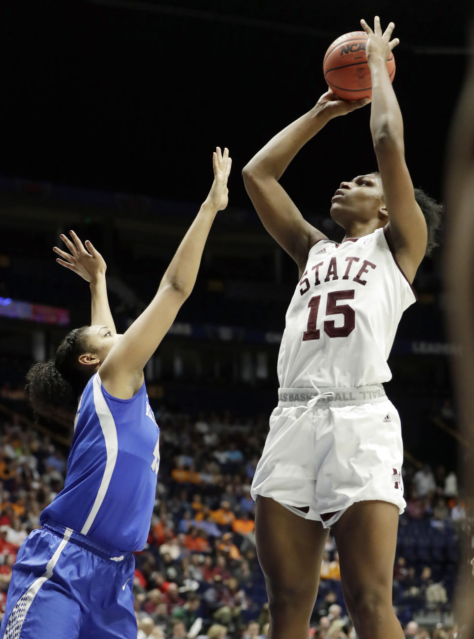 Mississippi State center Teaira McCowan (15) shoots over Kentucky's Alyssa Rice in the second half of an NCAA college basketball game at the women's Southeastern Conference tournament Friday, March 2, 2018, in Nashville, Tenn. Mississippi State won 81-58. (AP Photo/Mark Humphrey)