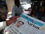 A newspaper bears the photograph of Pakistani surgeon Shakeel Afridi, recruited by the CIA to help find Osama bin Laden, at a newsstand in Karachi on May 24, 2012