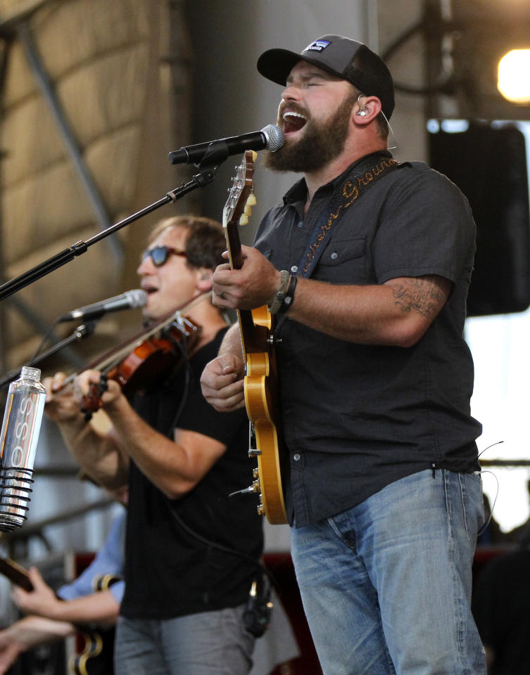 Zac Brown Band members Zac Brown, foreground, and Jimmy De Martini, perform with the group at the New Orleans Jazz and Heritage Festival in New Orleans, Friday, May 4, 2012. (AP Photo/Gerald Herbert)