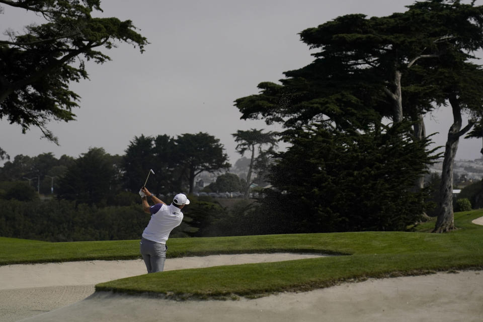 Dustin Johnson hits from the bunker on the 18th hole during the first round of the PGA Championship golf tournament at TPC Harding Park Thursday, Aug. 6, 2020, in San Francisco. (AP Photo/Jeff Chiu)