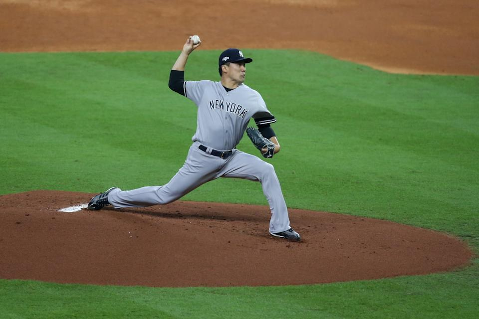 Oct 12, 2019; Houston, TX, USA; New York Yankees starting pitcher Masahiro Tanaka (19) throws against the Houston Astros in the first inning in game one of the 2019 ALCS playoff baseball series at Minute Maid Park. Mandatory Credit: Thomas B. Shea-USA TODAY Sports