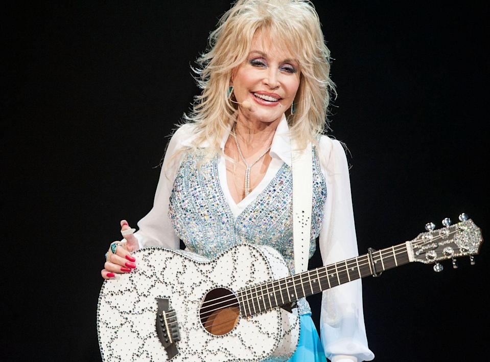 <p>Rock star 101: Get a guitar as bedazzled as your outfit.</p>