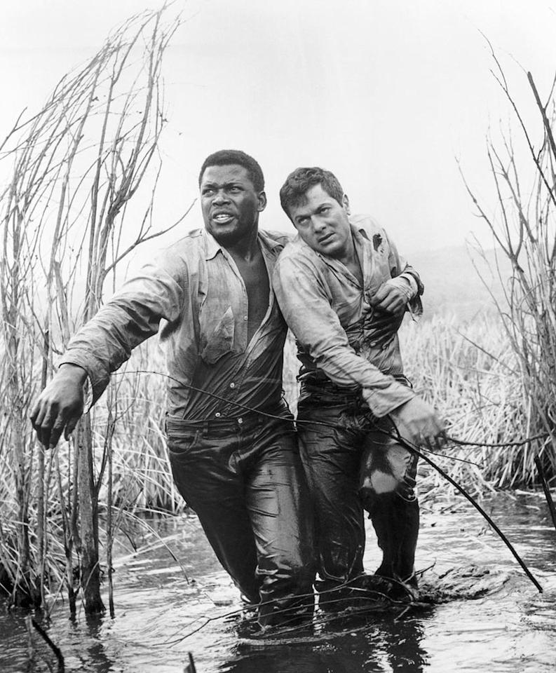 "Curtis nabbed his first and only Oscar nomination playing a bigoted prison escapee chained to a black convict played by <a href=""http://movies.yahoo.com/movie/contributor/1800025653"">Sidney Poitier</a>. Curtis reportedly insisted that Poitier get top billing for the movie."