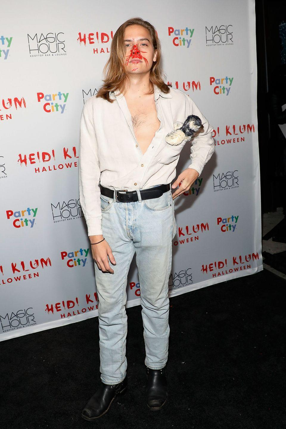 "<p>This costume is going to need an explanation. Fabio Lanzoni is an actor who has graced the cover of many a romance novel. He's pretty iconic for having windswept hair and an open shirt.</p><p>Dylan's costume is based on the aftermath of <a href=""https://www.youtube.com/watch?v=VeoT-QcYiXM"" rel=""nofollow noopener"" target=""_blank"" data-ylk=""slk:Fabio getting hit in face"" class=""link rapid-noclick-resp"">Fabio getting hit in face</a> by a bird as he was riding a roller coster.</p>"