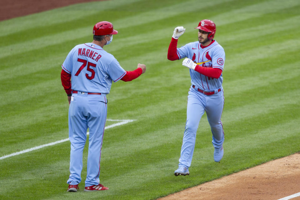 St. Louis Cardinals' Paul DeJong, right, is congratulated by third base coach Ron 'Pop' Warner, left, after hitting a home run during the third inning of a baseball game against the Philadelphia Phillies, Saturday, April 17, 2021, in Philadelphia. (AP Photo/Laurence Kesterson)