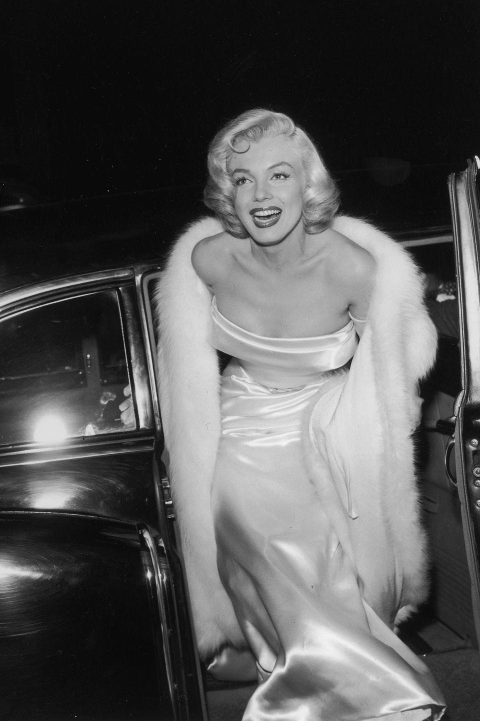 <p>Arriving at the premiere of <em>There's No Business Like Show Business</em> directed by Walter Lang in a strapless gown and fur coat. </p>