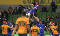 France's Cameron Woki is held aloft as he takes the ball during the second rugby test between France and Australia in Melbourne, Australia, Tuesday, July 13, 2021. (AP Photo/Asanka Brendon Ratnayake)