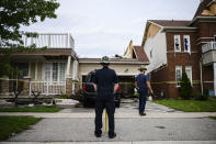 <p>Emergency services examine a home that has had its second floor blown off by a tornado, in Barrie, Ont., on Thursday, July 15, 2021. THE CANADIAN PRESS/Christopher Katsarov</p>