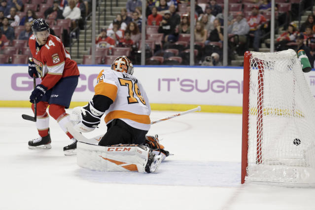Philadelphia Flyers goaltender Carter Hart (79) looks behind on a goal scored by Florida Panthers center Colton Sceviour, not shown, during the first period of an NHL hockey game, Tuesday, Nov. 19, 2019, in Sunrise, Fla. At left is Florida Panthers' Dominic Toninato (14). (AP Photo/Lynne Sladky)
