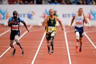 South Africa's Oscar Pistorius (centre) and USA's Blake Leeper (left) and David Prince during the Men's T44 100m during the Paralympic World Cup in Manchester.