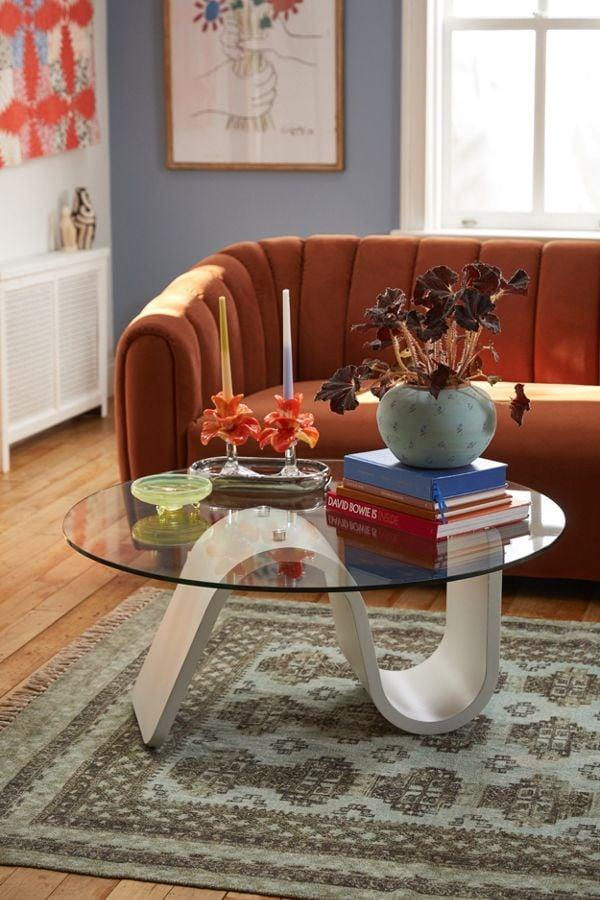 """<p>Your guests will want to know where this <a href=""""https://www.popsugar.com/buy/Bettie-Glass-Coffee-Table-543188?p_name=%20Bettie%20Glass%20Coffee%20Table&retailer=urbanoutfitters.com&pid=543188&price=399&evar1=casa%3Aus&evar9=47140357&evar98=https%3A%2F%2Fwww.popsugar.com%2Fhome%2Fphoto-gallery%2F47140357%2Fimage%2F47140378%2FBettie-Glass-Coffee-Table&list1=shopping%2Curban%20outfitters%2Cfurniture%2Csmall%20space%20living%2Chome%20shopping&prop13=api&pdata=1"""" rel=""""nofollow"""" data-shoppable-link=""""1"""" target=""""_blank"""" class=""""ga-track"""" data-ga-category=""""Related"""" data-ga-label=""""https://www.urbanoutfitters.com/shop/bettie-glass-coffee-table?category=furniture&amp;color=010&amp;type=REGULAR"""" data-ga-action=""""In-Line Links""""> Bettie Glass Coffee Table </a> ($399) is from.</p>"""