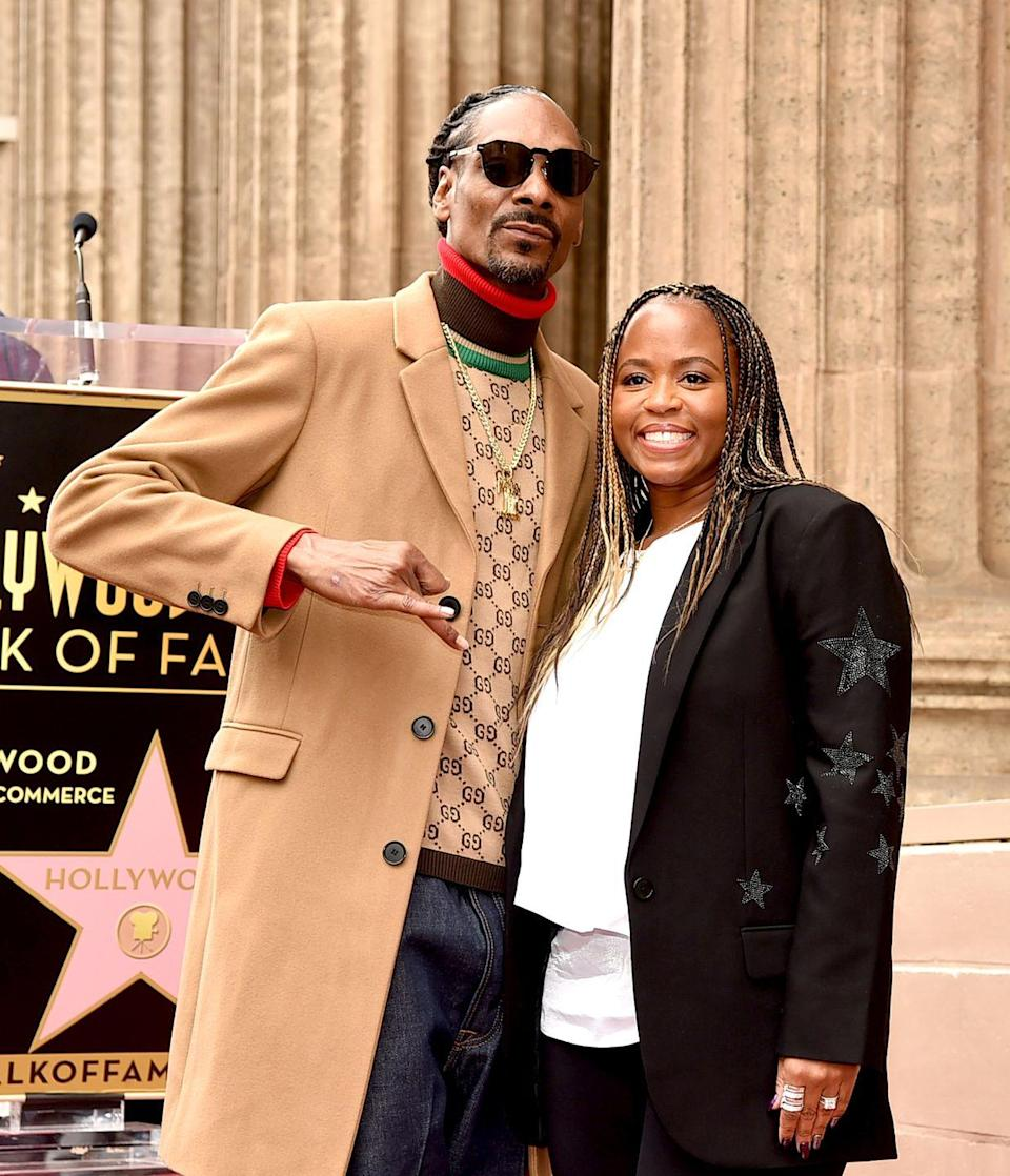 """<p>Snoop Dogg married his high school sweetheart, Shante Taylor Broadus, in 1997. They had three children together and were married for eight years when the rapper <a href=""""https://allhiphop.com/news/snoop-dogg-files-to-divorce-wife/"""" rel=""""nofollow noopener"""" target=""""_blank"""" data-ylk=""""slk:filed for divorce"""" class=""""link rapid-noclick-resp"""">filed for divorce</a> in 2004, citing irreconcilable differences. But the couple called off their divorce and reunited after their <a href=""""https://people.com/archive/snoop-dogg-lupus-united-our-family-vol-73-no-28/"""" rel=""""nofollow noopener"""" target=""""_blank"""" data-ylk=""""slk:daughter was diagnosed with Lupus"""" class=""""link rapid-noclick-resp"""">daughter was diagnosed with Lupus</a>. """"It's amazing how this all turned out. We were gonna get a divorce. But we wouldn't have gotten through it [that way],"""" Shante told <a href=""""https://people.com/archive/snoop-dogg-lupus-united-our-family-vol-73-no-28/"""" rel=""""nofollow noopener"""" target=""""_blank"""" data-ylk=""""slk:People"""" class=""""link rapid-noclick-resp""""><em>People</em></a>. In 2008, they <a href=""""https://www.hiphollywood.com/2018/05/exclusive-snoop-dogg-reveals-how-charlie-wilson-saved-his-marriage/"""" rel=""""nofollow noopener"""" target=""""_blank"""" data-ylk=""""slk:renewed their vows"""" class=""""link rapid-noclick-resp"""">renewed their vows</a>. </p>"""