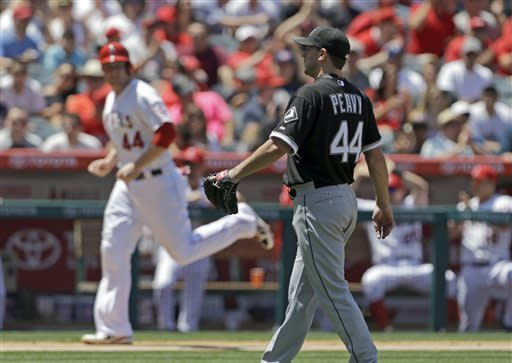 Chicago White Sox pitcher Jake Peavy watches as Los Angeles Angels' Mark Trumbo, background, scores on a bases-loaded walk in the fourth inning of a baseball game in Anaheim, Calif., Sunday, May 19, 2013. (AP Photo/Reed Saxon)