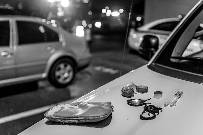 <p>Drug paraphernalia is seen on a car hood as the Middletown Fire Department responds to a call about a woman possibly overdosing on heroin. (Photograph by Mary F. Calvert for Yahoo News) </p>