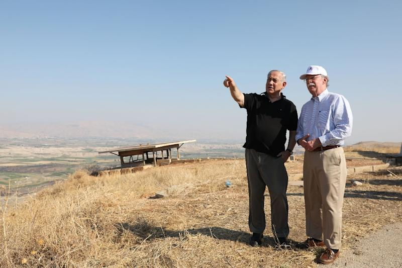 Israeli Prime Minister Benjamin Netanyahu and US National Security Advisor John Bolton visit an army outpost overlooking the Jordan Valley