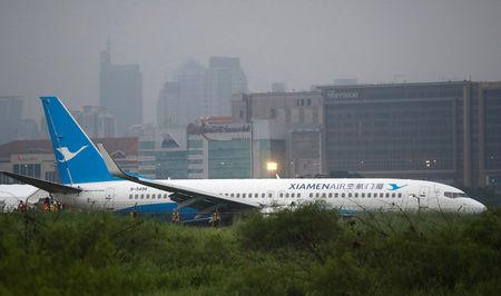 Boeing skids off rainy Manila runway, rips off engine, wheel