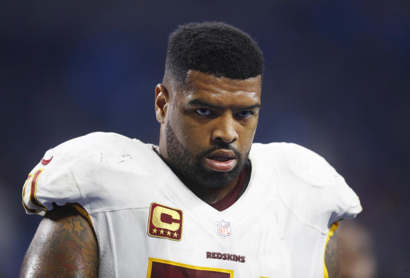 FILE - In this Oct. 23, 2016, file photo, Washington Redskins tackle Trent Williams walks in the bench area during the team's NFL football game against the Detroit Lions in Detroit. Williams has been suspended for four games for violating the NFL's substance abuse policy. It's his second four-game suspension and first since 2011. He tested positive multiple for marijuana multiple times over the summer of 2011 and served it that season. (AP Photo/Paul Sancya, File)
