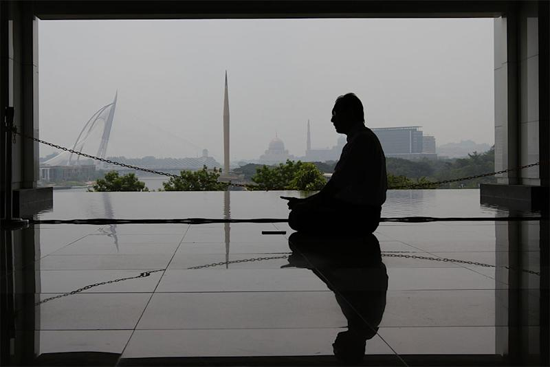 A Muslim performs his prayers at the Tuanku Mizan Mosque in Putrajaya. Zamri said punishments in Islam are geared towards building a clean society.— Picture by Yusof Mat Isa