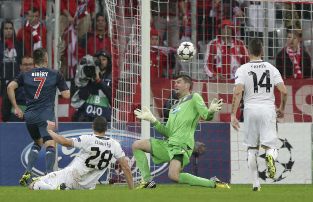 Bayern's Franck Ribery , left, scores his side's 3rd goal past Viktoria Plzen goalkeeper Matus Kozacik, right, during the Champions League group D soccer match between FC Bayern Munich and Viktoria Plzen in Munich, Germany, Wednesday, Oct. 23, 2013. (AP Photo/Matthias Schrader)